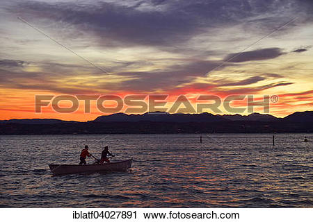 """Stock Photography of """"People on a boat in Lake Garda, Lago di."""