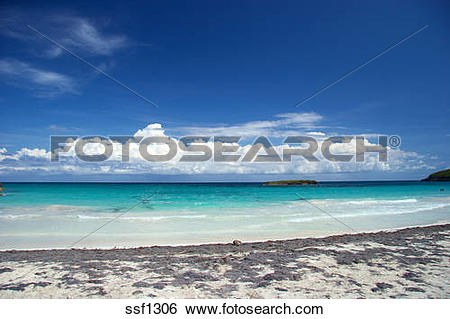 Stock Images of Wide view of storm clouds with deserted beach in.