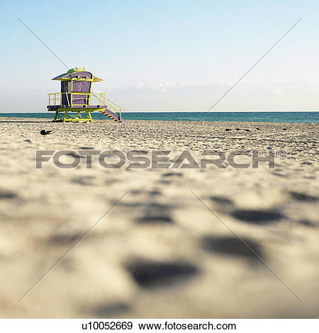 Stock Photograph of Art deco lifeguard tower on deserted beach in.
