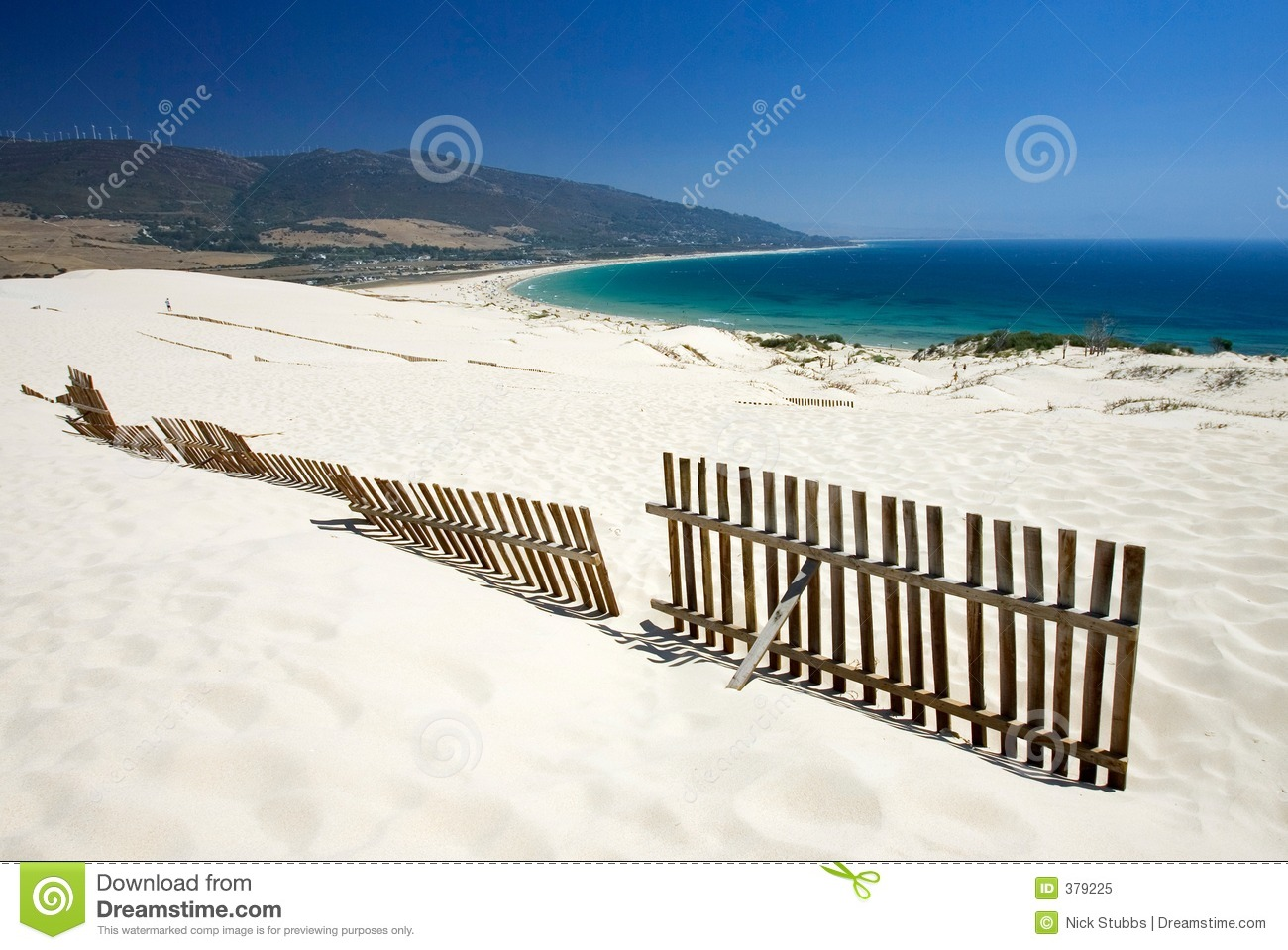Old Fence Sticking Out Of Deserted Sandy Beach Dunes Royalty Free.