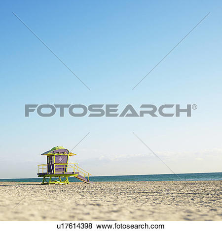 Pictures of Art deco lifeguard tower on deserted beach in Miami.