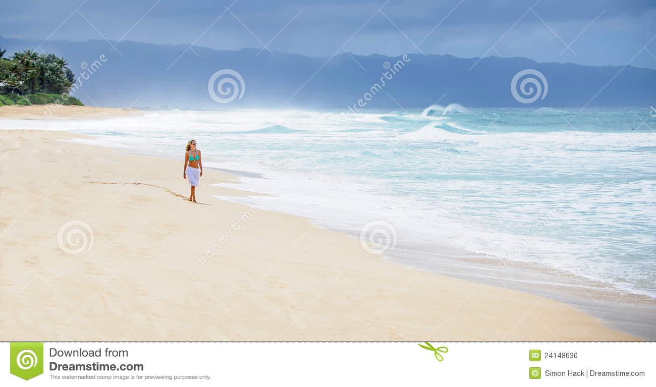 Girl Walking On Deserted Beach Stock Photo.