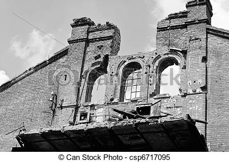 Stock Images of Abandoned ruins against the sky. Black and white.