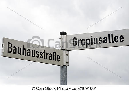 Stock Image of Street signs near Bauhaus building in Dessau.
