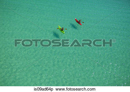 Stock Image of Two people canoeing in Gulf of Mexico, Destin.