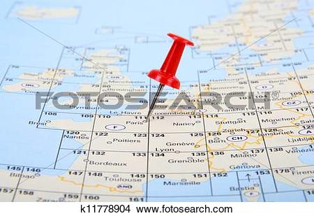 Stock Photo of Red pin show the location of a destination point on.