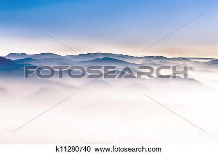 Stock Photography of Misty mountain hills landscape detail view.