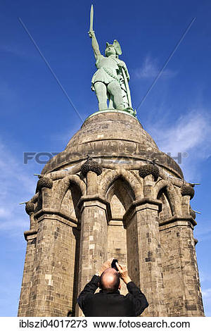 """Stock Photo of """"Man photographing the Hermannsdenkmal monument."""