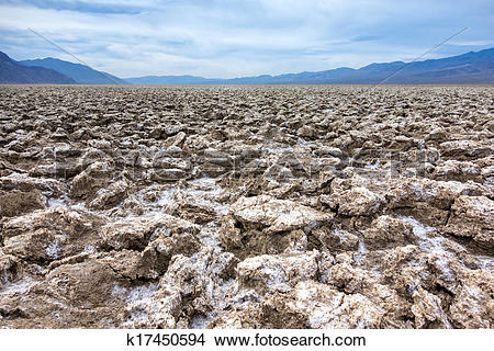 Stock Photo of The rough ground and salt crystals which form the.
