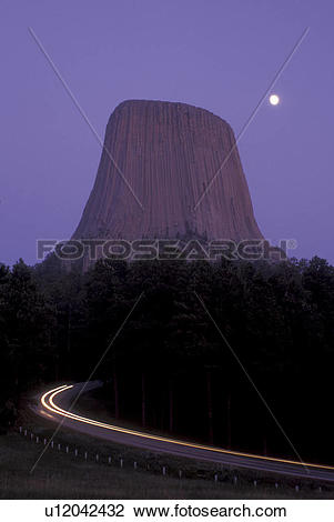 Stock Photo of Wyoming, Full moon rises over Devils Tower National.