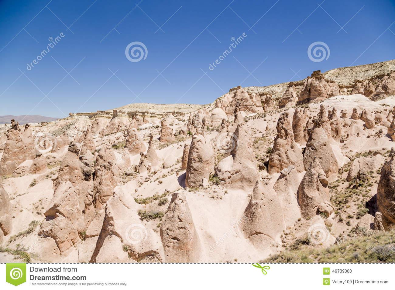 Cappadocia, Turkey. Mountain Devrent Valley With Figures Of.