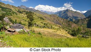 Stock Images of Beautiful village in western Nepal with Dhaulagiri.