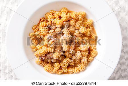 Stock Photo of radiatore pasta with irish bacon.