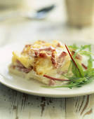 Stock Photo of Gratin Dauphinois with diced bacon and ham 074994.