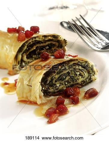 Stock Photo of Savoury strudel with kale filling and diced bacon.