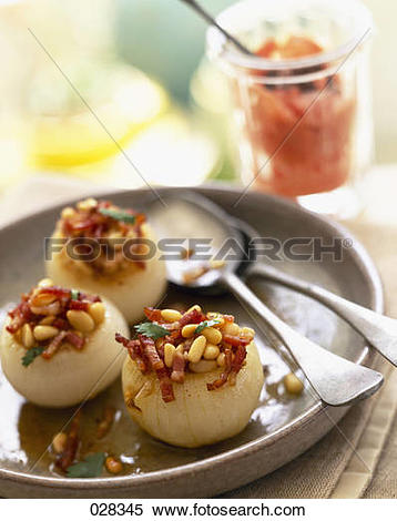 Stock Image of Stuffed onions with diced bacon and pine nuts.