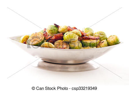 Stock Photo of fried brussels sprouts with chopped bacon.