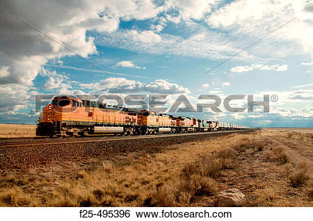 Stock Images of Five diesel electric locomotives pull long train.