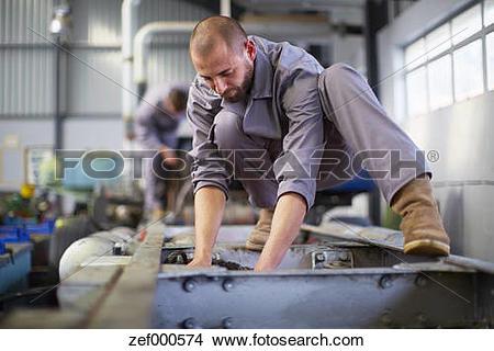 Stock Photo of Diesel mechanic at work zef000574.