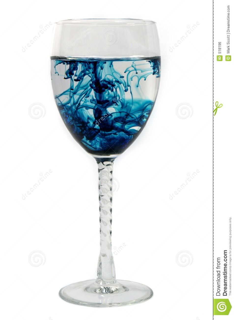 Blue Diffusion In A Glass Royalty Free Stock Image.