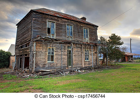 Stock Photo of Old abandoned two story wooden farmhouse.