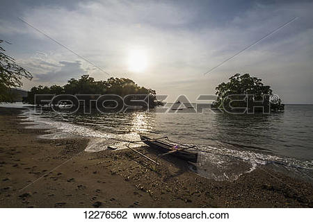 Stock Photo of Boat and mangroves in Areia Branca; Dili, East.