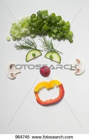 Stock Image of Amusing face made from vegetables, dill and.