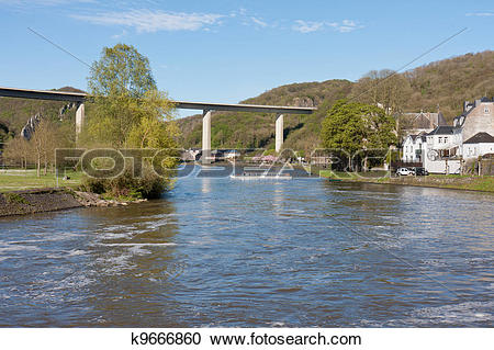 Stock Photography of River Meuse near Dinant in Belgium, a highway.