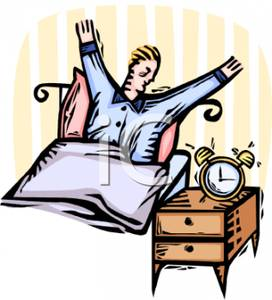 A Man Yawning and Stretching As His Alarm Clock Dings.