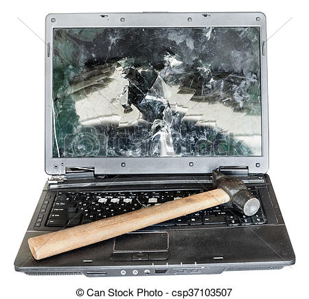 Stock Photography of direct view of old broken laptop with hammer.