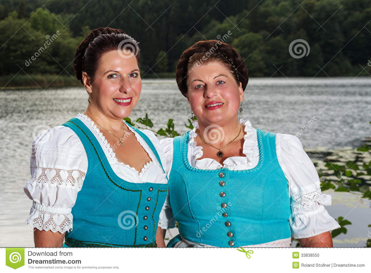 Two Happy Bavarian Ladies In Dirndls Stock Photo.