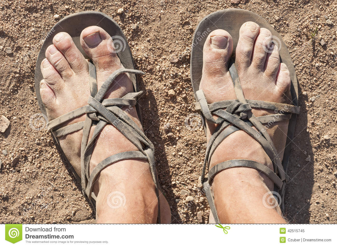 Dirty feet in sandals stock image. Image of sandals, angle.