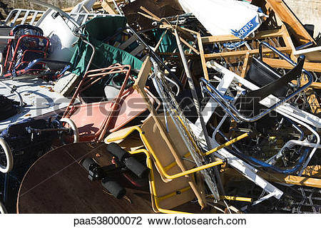 Stock Photo of Discarded household items piled up paa538000072.