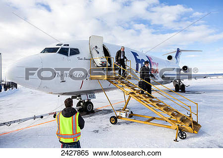 Stock Image of Pilots disembark from a FedEx 737 cargo plane after.