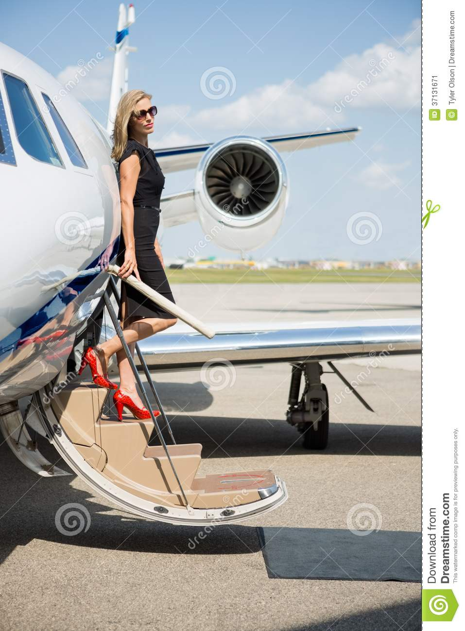 Rich Woman Disembarking Private Jet Stock Image.