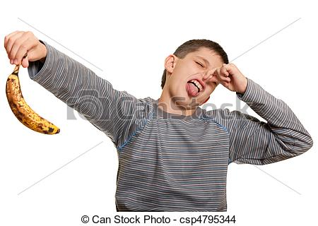 Stock Photo of Dissatisfied kid holding an ugly banana.