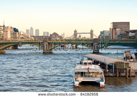 The River Thames With London Bridge,Tower Bridge And Canary Wharf.