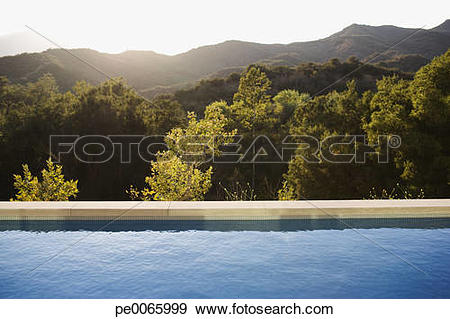 Stock Photograph of Swimming pool and distant hills pe0065999.