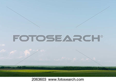 Stock Photo of Vista Of Green Fields And Distant Hills; Canada.