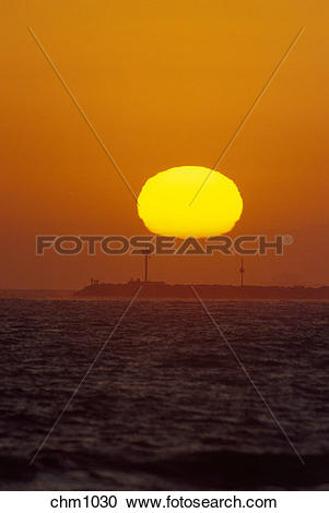 Stock Photography of The yellow sun appears to flatten out as it.