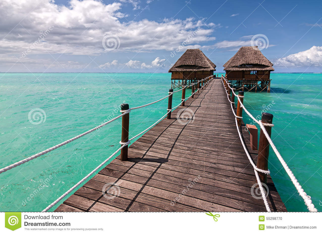 Wooden Jetty To Ocean Huts Stock Photo.