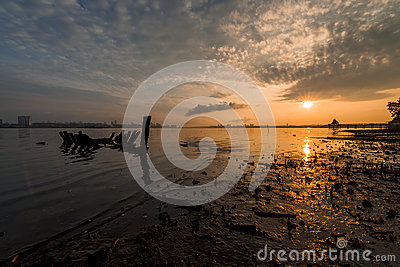 Reflection Of Fishing Boat On Beach With Jetty Background Stock.