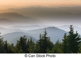 Stock Photography of Distant mountain range and thin layer of.