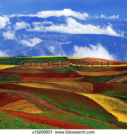 Stock Photography of Overlook of red soil and distant mountain.