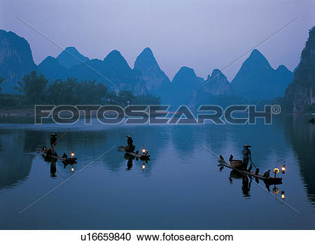 Stock Photography of Fishermen on boat and distant mountain.