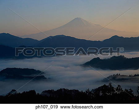 Stock Photograph of Distant view of Mount Fuji silhouetted against.