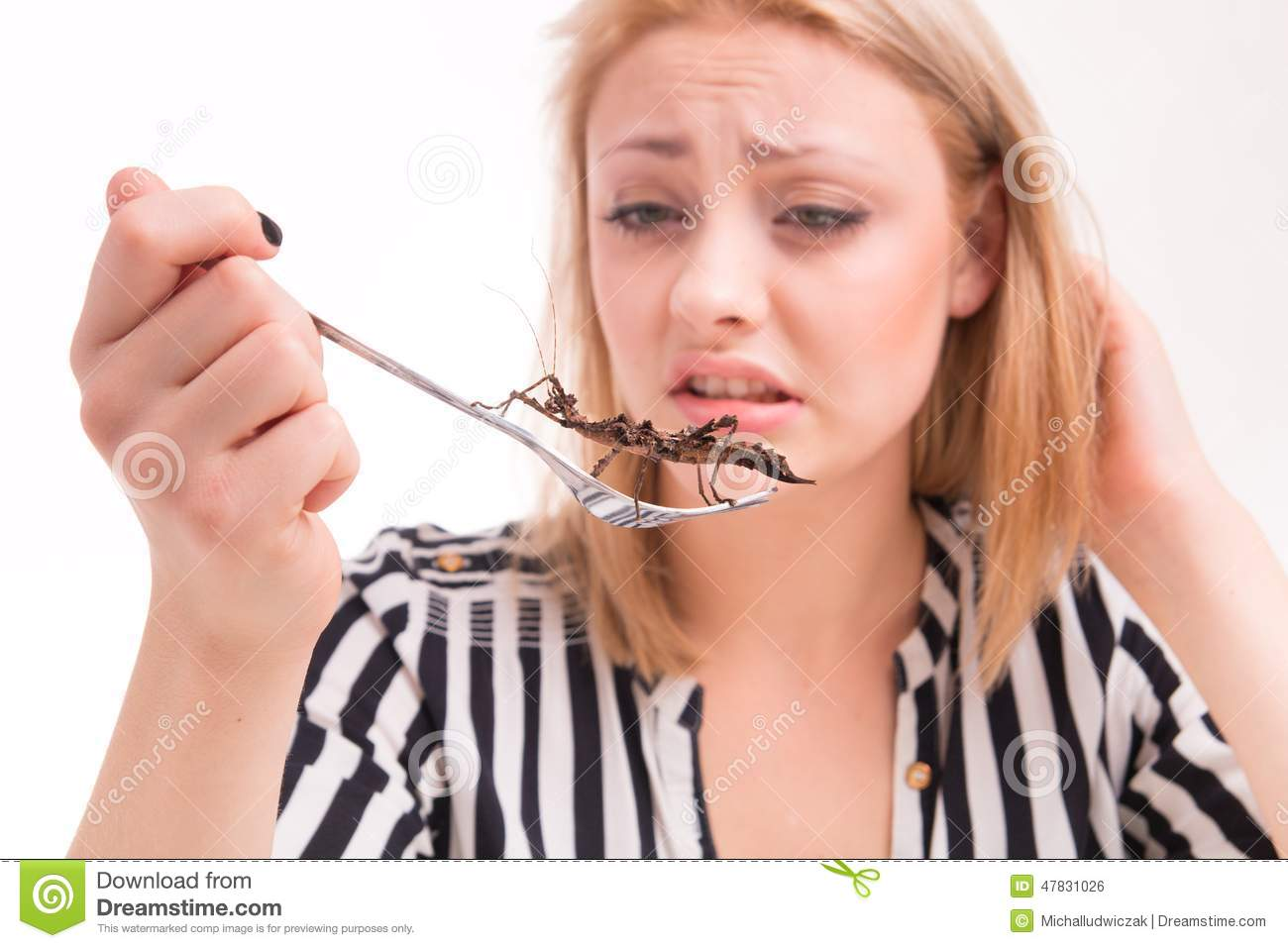 Disgusted Woman Eating Insects With A Fork In A Restaurant Stock.