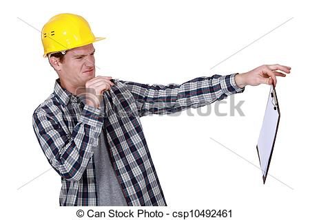 Stock Image of Construction worker holding a distasteful clipboard.