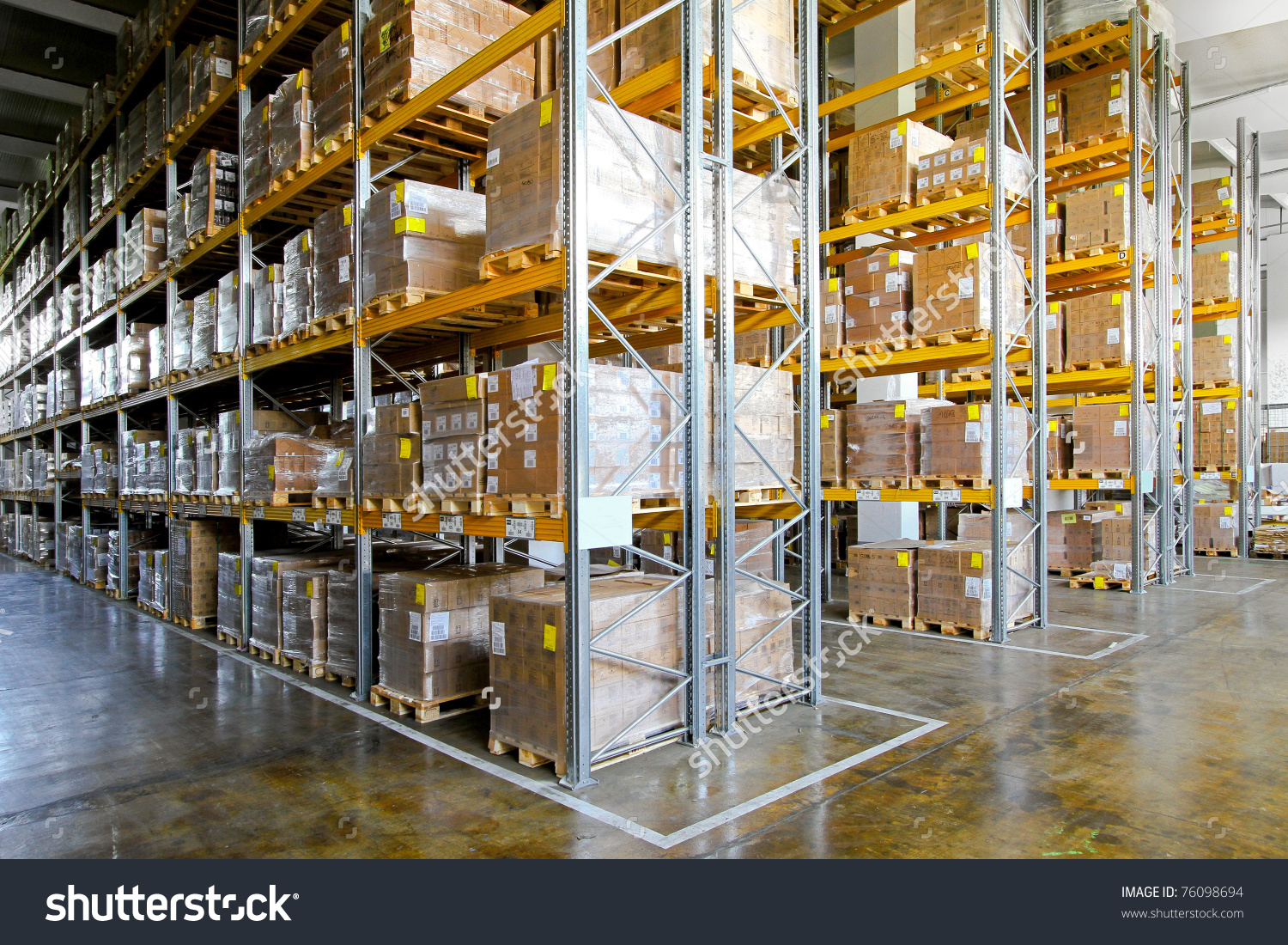 Shelves And Racks In Distribution Storehouse Interior Stock Photo.