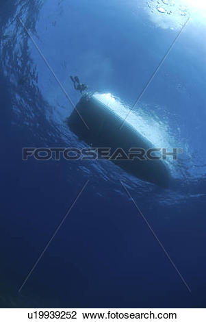 Stock Photo of Dive boat silhouette against surface, Cayman.